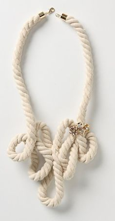 DIY Rope Necklace.  *** I'm not sure if I like it enough to wear this but I think it is a really cool look.  I think it would be a very unique curtain tie-back; maybe in a   pirate/nautical themed kid's room.