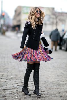 In lust with this. A fringe skirt paired with a black jacket and knee-high boots.