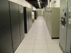 """The air handlers and other mechanical equipment are housed in separate corridors, separate from the servers in the raised-floor area. This allows for more """"white space"""" being dedicated to servers, and allows vendors to service the equipment without requiring access to the server area. (Photo: Rich Miller)."""