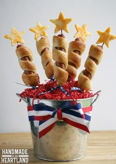 Wrap hot dogs in flaky dough and top with cheese stars for a fun and festive appetizer.