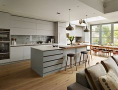 Roundhouse Urbo matt lacquer bespoke kitchen in Pearl Ashes 3 by Fired Earth and island in Graphite 4 by Fired Earth.