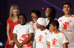 Pin for Later: 40 Pictures of Charitable Celebrities Giving Back Taylor Swift Taylor met up with young ambassadors from Save the Children for a Christmas event in London in November 2012.