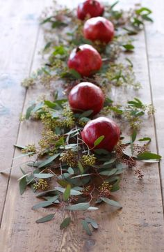 Whether they're faux or fresh, these juicy red fruits are a simple element to display — add some greens to give the look a pretty contrast. See more at Julie Blanner » What you'll need:fake pomegranates ($13 for a 6-pack, amazon.com)
