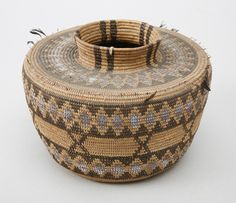 Central Californian jar-shaped basket, Tulare Lake area, possibly Yokuts, sedge root coiled on a grass bundle foundation, design in redbud and bracken fern root, early 1900s. Subjects: bottleneck baskets, bundle foundation, diamond designs, rattlesnake designs, x shape