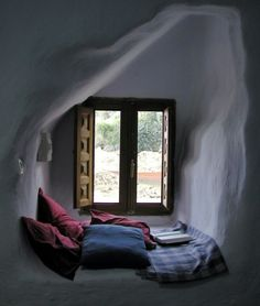 reading nook: i like how self contained, and the soft sloping ceiling, and the window like a keyhole