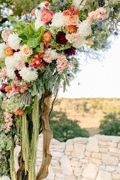 These flowers are gorg! http://www.stylemepretty.com/little-black-book-blog/2015/03/12/rustic-fall-wedding-at-paniolo-ranch/ | Photography: Mint Photo - http://mymintphotography.com/