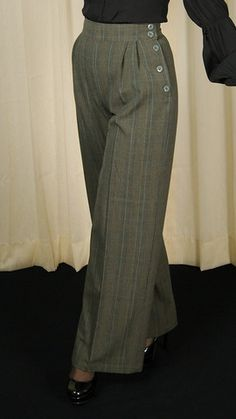 These are elegant and classic 1940s style wide leg trousers! They are grey, black and beige with blue pinstripe Glen Plaid fabric or Prince of Whales check as its often called. The trousers feature a 2 inch wide waist band, high waist(wi...