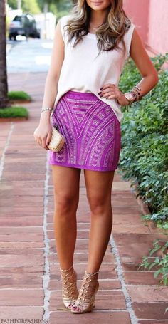 Summer dress of a girl wearing violet short skirt
