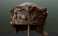 The 'Hallaton Helmet' a 2,000-year-old Roman helmet found at an old Iron Age site at Hallaton in Leciestershire in 2002 is to go on display at the Harborough Museum.     The helm is made from sheet iron and still has it's silver gilt plating intact -- the first one found in the UK in this condition.    Helm shows Roman military victory scenes, including an Emperor on horseback, trampling someone under his hooves.