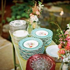 Vintage China | Inspired by her grandmother's love of china, the bride decided to serve dinner on mixed china patterns. Instead of renting so many different sets, she and her mom scoured thrift shops, flea markets, and antiques stores to collect enough to serve all 275 guests. | SouthernLiving.com