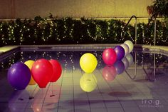 Balloons with weights in the pool