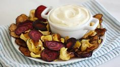 Blogger Stephanie Wise of  Girl versus Dough shares a recipe for baked veggie chips with a curried yogurt dip, perfect for healthy snacking.