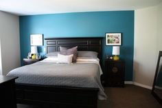 "Our Master Bedroom: Black Furniture, custom Asian side tables, West Elm bedside lamps, Grey bedding from Target, Benjamin Moore ""Naples Blue"" accent wall, Benjamin Moore ""Revere Pewter""on walls"