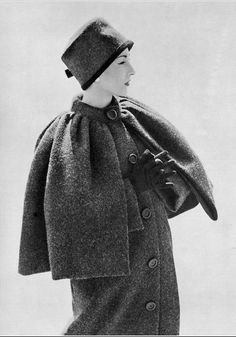 1956 Renée Breton in gray Shetland wool coat with short cape by Christian Dior