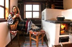 Romanian traditional outfit and old kitchen. Folk Embroidery, Embroidery Patterns, Moomin House, French Bohemian, Romanian Food, Stove Fireplace, Old Kitchen, Antique Quilts, Traditional Kitchen