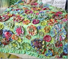 another reason I need to learn to sew- so I can make this Amy Butler quilt... so cute!