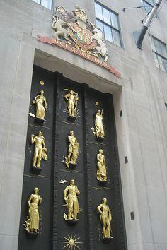 Rockefeller Center door decorated with statues, New York City