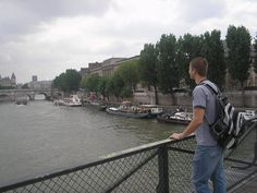 Paris - My son overlooking one of the many bridges over the Reine River