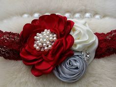 ~Red Ivory & Silver Vintage Headband~ https://www.facebook.com/OohLaLaDivasandDudes  This beautiful headband features vintage inspired flowers on a matching headband. The center of the bow is made of beautiful pearl and rhinestone clusters. Our flowers are felt backed for comfort. Simple and yet elegant, sure to be a real head turner!! Pair it with one of our adorable lace petti rompers for a complete look. Choose your colors! I have listed a photo of most of the shabby flowers that can be…
