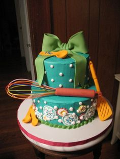 Bridal shower cake that stirs up the cooking theme.  See more bridal shower cake ideas at www.one-stop-party-ideas.com
