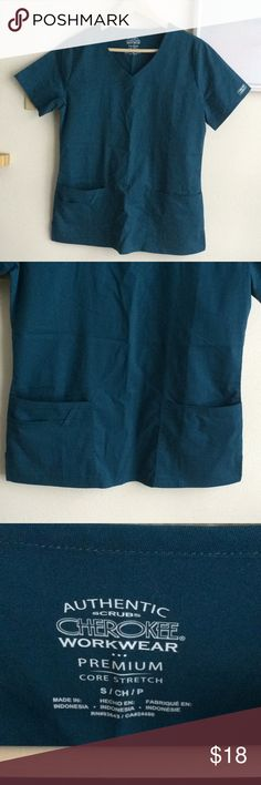 Cherokee scrub top Brand new. Caribbean blue color. Missy fit. Plenty of pockets! There's even a pocket for a pen or two on the right lower end of the scrub. In perfect condition. Cherokee Tops
