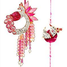 Bhaiya Bhabhi Rakhi Set: Set of rakhi and lumba for Bhaiya and Bhabhi. The beautiful Lumba (rakhi for Bhabhi) is made of a intricate meena kundan motif and pink zardozi work with small pink and white diamond stones. Small white pearls with small pink and golden stones dangling at the bottom. It has a matching diamond rakhi for brother. Costs Rs 1337/- http://www.tajonline.com/rakhi-gifts/product/rdr72/bhaiya-bhabhi-rakhi-set/?aff=pinterest2013/