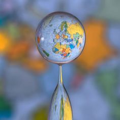 """Markus Reugels -- """"Big World in a Little Drop"""" -- Markus placed a map of the world behind the water splash"""