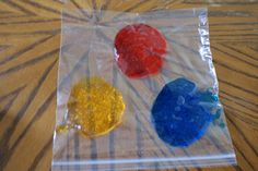 Great idea for exploring colors using food coloring and hair gel in a plastic bag from Duck Duck Octopus.
