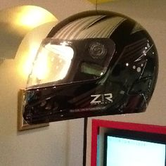 Race car helmet turned light fixture.  (orthodontist office)
