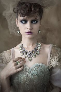 Love the look.  great for couture or romantic photo shoot with the dark smokey eye and great light blue dress.