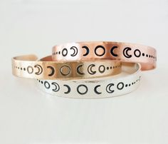 Moon phase bracelets by Zenned Out in copper, brass and sterling silver.