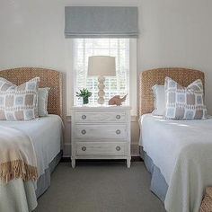 Beige and blue bedroom features two seagrass headboards on twin beds dressed in beige and blue ikat pillows and a blue… Beach House Bedroom, Blue Bedroom, Girls Bedroom, Bedroom Decor, Twin Bedroom Ideas, Trendy Bedroom, Small Guest Rooms, Guest Bedrooms, Tiny Bedrooms
