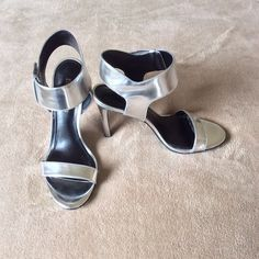 Enzo Angiolini Metallic Silver Sandals These sandals include the following features: silver metallic color, open toes with strap across toe area, 1 inch strap wraps around ankle with velcro closure, 4 1/2 inch heels, 8 1/2 M, Worn once and in excellent condition. Enzo Angiolini Shoes Sandals