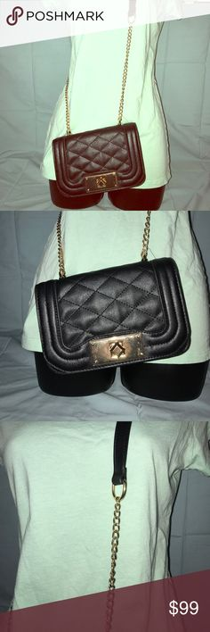 Wet Seal Black & Gold Cross Body Purse NWT 💕Wet Seal Black & Gold Cross Body Purse NWT💕 💕Width: 6in, Length: 3in (pictures)💕 💕Length of strap: 21 (pictures)💕 💕Adjustable shoulder strap💕 💕No snags, rips, Smoke Free House💕 Wet Seal Bags