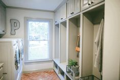 Absolutely love everything about this laundry room/mud room!  The built in cubbies are perfect and the floor is amazing!
