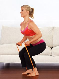 Stand with feet hip-width apart on center of band so that your back is facing couch, holding ends of band in each hand with arms by sides and palms facing forward; stand about 18 inches from edge of cushion.  Keeping elbows by sides, curl hands toward shoulders as you lower into a squat, barely touching edge of cushion.  Stand up quickly, lowering arms by sides.  Do 15 reps.