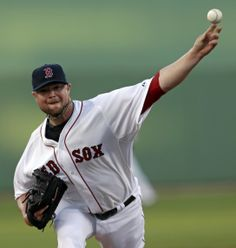 Boston Red Sox starting pitcher Jon Lester pitches in the first inning of an exhibition baseball game against the Philadelphia Phillies in Fort Myers, Fla., Saturday, March 15, 2014. (AP Photo/Gerald Herbert)