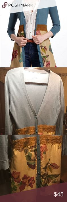 """Knitted and knotted cardigan size large """"Foliage"""" empire waist cardigan sweater, top is blue knit, bottom is floral on a gold background, too and bottom divided by lace. Knit trim, buttons on trim. Upper portion is 100% cotton, lower is 100% polyester. Split, angled, cuff on sleeves. Thank you for looking. Anthropologie Sweaters Cardigans"""
