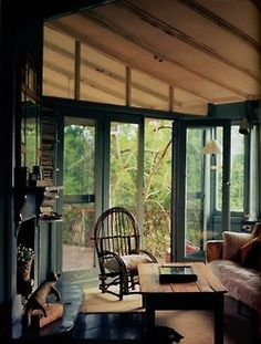 twotonmantaray:  dyingofcute:Indoor porch with rustic decor and a little book shelving
