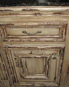 Painted and distressed faux wood. Work by Tiffany Alexander of Blank Canvas Design Studio.