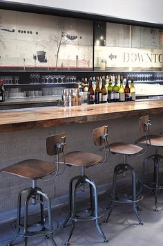 Bar Agricole, stools. Rustic chic. These remind me of my father's work bench in the basement growing up - he has a chair like this.