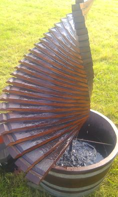 Spiral barrel stave water feature https://www.facebook.com/oakbarrelcreations.uk