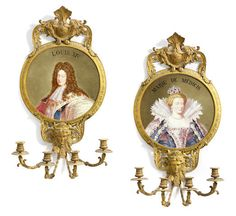 A pair of Louis XVI style gilt bronze and earthenware wall plaques late 19th/early 20th century. The circular panels painted with portraits of Marie de Medici and Louis XIV, signed Lebert, pseudo interlaced Ls mark to reverse, with pierced foliate cresting above and mask ornament below, issuing four candle arms.