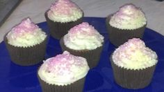 Vanilla cupcakes, vanilla frosting topped with pink sugar sparkles.