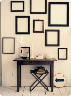 I love the idea of hanging empty frames as decor! Get them cheap at goodwill
