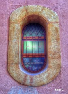 Torredembarra, Tarragona, Spain painted or stained glass oval window with stone frame