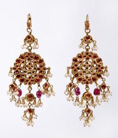 A pair of gold ear pendants, set with diamonds, the reverse  is set with rubies, suspended are pearls and spinels. Late 19th century