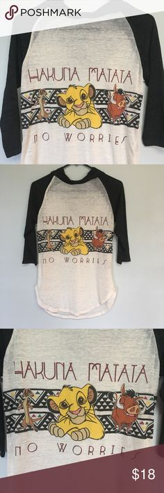 """Disney Lion King tee This cute tee has the famous saying """"Hakuna Matata"""". It's semi sheer and lightweight with a hood. It has three quarter inch sleeves. Make an offer! Disney Tops"""