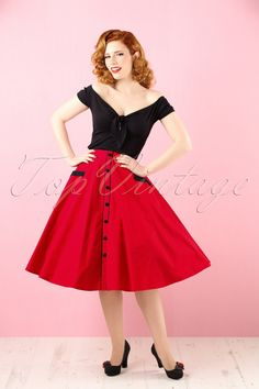 "Rock 'n roll the night away in this '50s Martie Polkadot Swing Skirt! Her sassy black pin dots, row of black ""faux"" buttons and cute pockets make her a real eyecatcher! Made from a supple, lipstick red cotton (doesn't stretch) that will playfully swing while you dance. One, two, three o'clock, four o'clock shop, we're gonna rock around the clock tonight! Full swing skirt Waist style Row of ""faux"" buttons at the front Black..."
