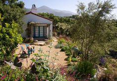 So many wonderful things: white stucco, teal trim, lovely landscaping!  Photo via Grace Design Associates website